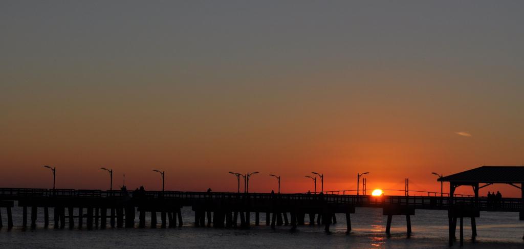 Sun setting behind the pier on St Simons Island